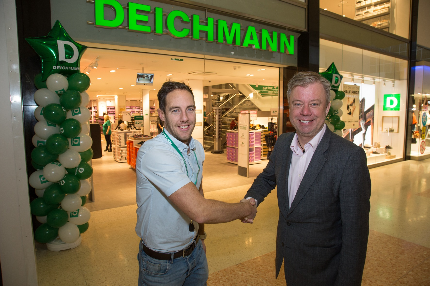 Opening of the new Deichmann shop in The Dolphin Shopping Centre in Poole, Dorset. Regional Store Manager Adrian Burnell with John Grinnell, Dolphin Shopping Centre Manager.