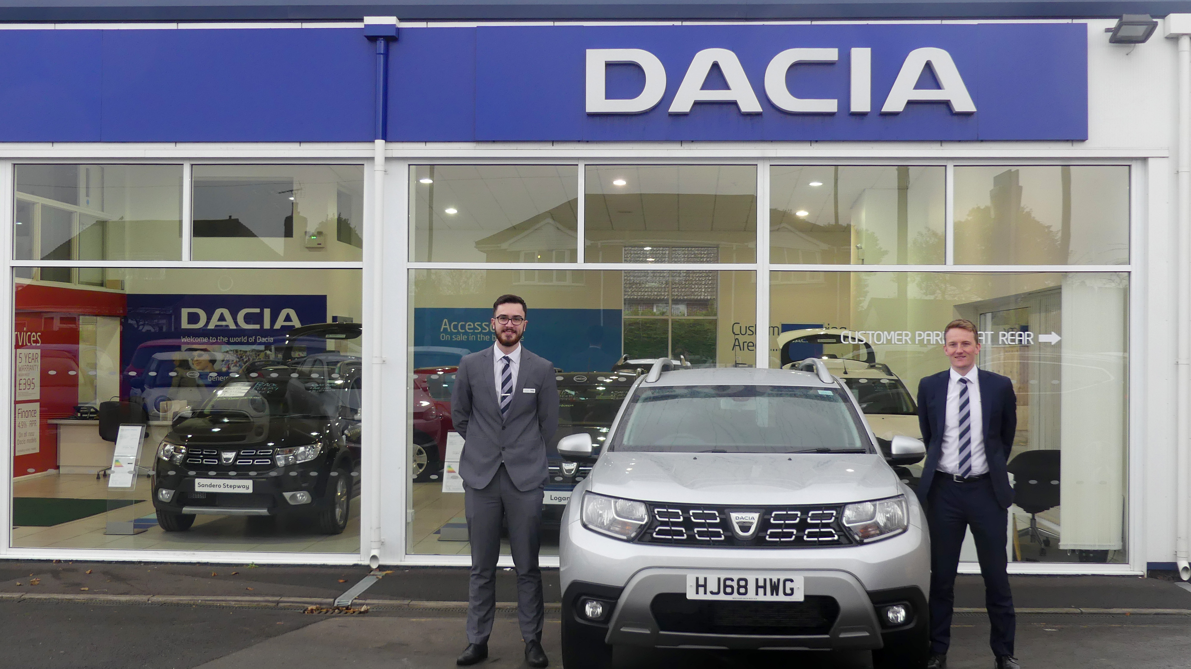 James Butler and Scott Harron salesmen at Westover Dacia with Dacia Duster